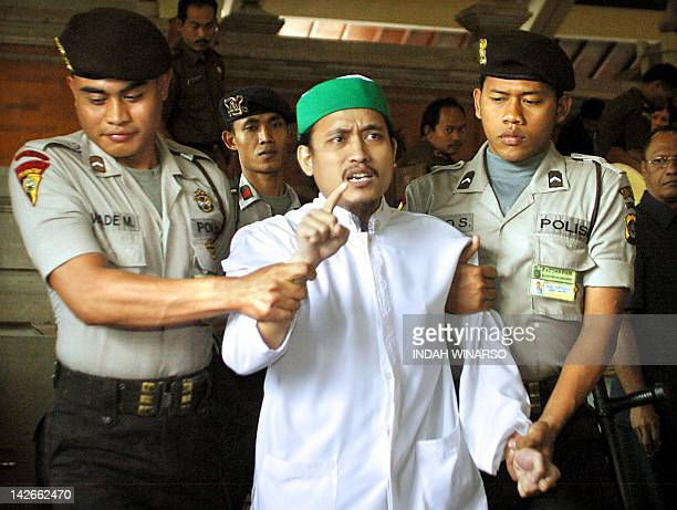 Indonesian terror key suspect Abdul Aziz alias Imam Samudra shouts after his trial in Denpasar Bali 07 July 2003 A statement claiming responsibility...