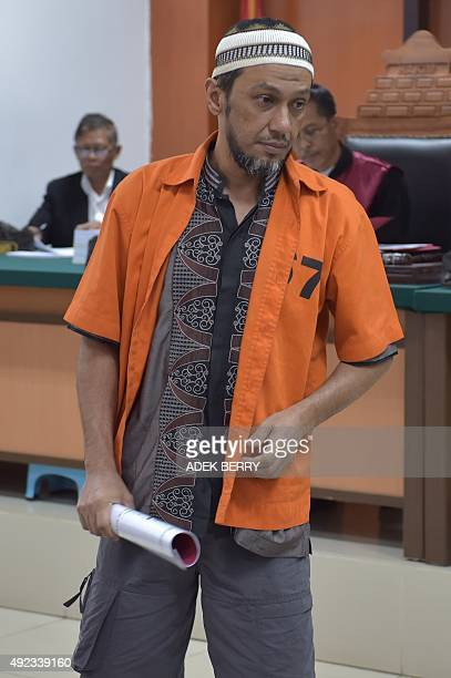 Indonesian terror suspect Helmi Muhamad Alamudi alias Abu Royan attends his trial at the West Jakarta court in Jakarta on October 12 2015 Seven...