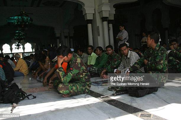 Indonesian TNI soldiers worships at the first mosque service at the Baitulrahman Raya Mosque in central Banda Aceh on Friday 7 January 2005 SMH NEWS...