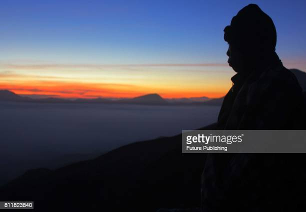 Indonesian tourists wait for members of the Tengger tribe as the sun rises at mount Bromo volcano during the Yadnya Kasada Festiva on July 10 2017 in...