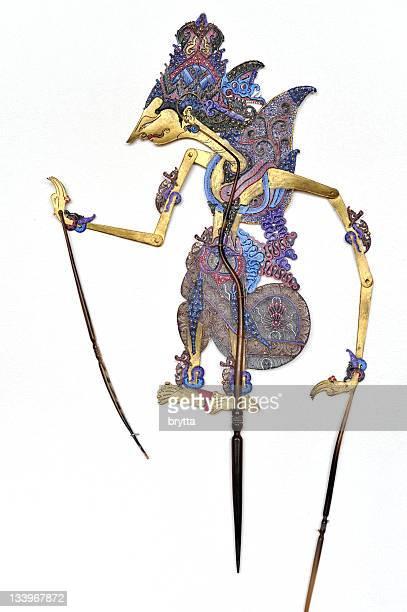 Indonesian traditional Wayang Kulit  puppet hanging on white wall