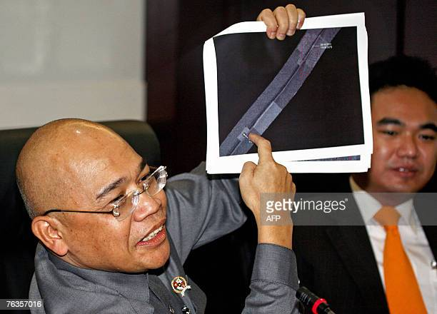 Indonesian Transport Minister Jusman Syafii Djamal displays an image showing the location of the black boxes from an Indonesian airliner that crashed...