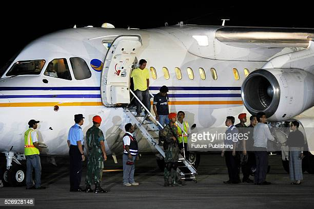 Indonesian tugboat crewmen who were taken hostage by Abu Sayyaf militants in the Philippines disembark their plane upon arrival at Halim...