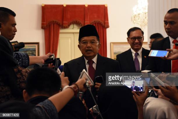 Indonesian Vice President Jusuf Kalla answers the questions of press members during an inauguration ceremony at the State Palace in Jakarta Indonesia...