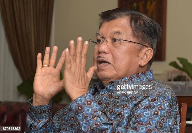 Indonesian Vice President Jusuf Kalla speaks during an interview with AFP at his office in Jakarta on April 25, 2017. Indonesia's vice president on...