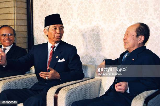 Indonesian Vice President Sudharmono and Japanese Prime Minister Kiichi Miyazawa talk during their meeting at the prime minister's official residence...