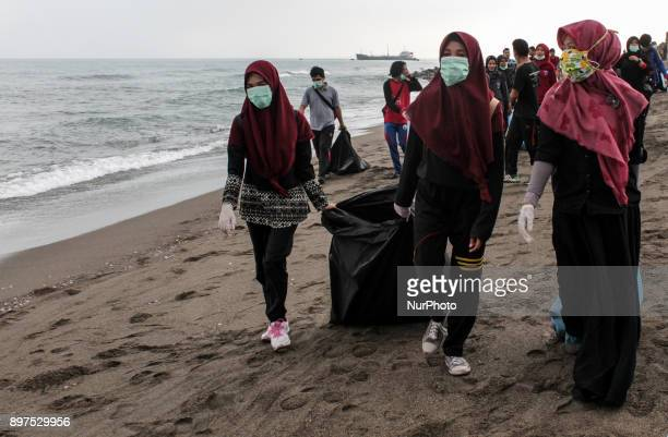 Indonesian volunteers take environmental action by clearing garbage on the coast of Lhokseumawe Aceh province Indonesia On December 23 2017 Indonesia...