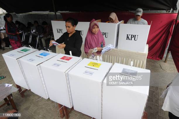 Indonesian voters cast their ballots during a revote due to some discrepancies in Tangerang on April 24 one of some 800000 polling booths nationwide...