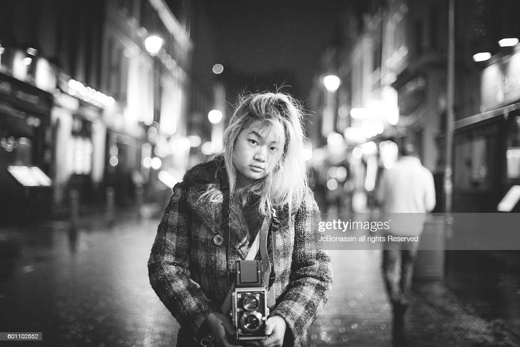 Indonesian Woman with a camera : Stock Photo