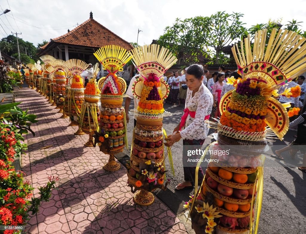 Indonesian women carry fruit and chicken as ritual offerings during Odalan ceremony at Pura Dalem Bitra Gianyar in Bali, Indonesia on February 2, 2018. Odalan is a traditional ceremony to commemorate the founding of the temple that has been reserved for religious rituals and activities. Based on the Balinese Saka calendar, Odalan is held every six months.