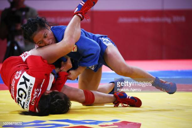 Indonesian women sambo fighter Maria Magdela Ince fights Anara Zhumali Kyzy on Women's Sambo 48kg quarter final Asian Games 2018 at Jakarta...