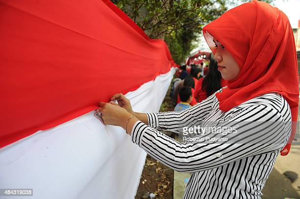 Indonesian women sew 500 meters length Indonesian flag as part of the 70th Indonesia National Independence day celebration on August 17 2015 in...