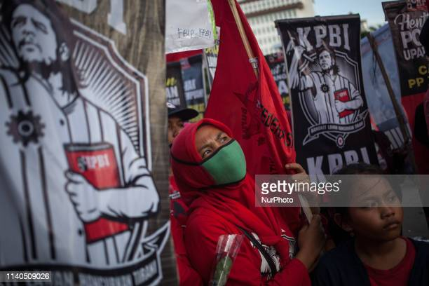 Indonesian worker listen to the oration during May Day rally in Jakarta on May 1 2019 Thousands of Indonesian workers are urging the government to...