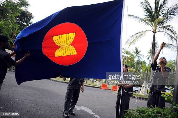 Indonesian worker raise an Association of South East Asian Nation's flag surrounding the ASEAN venue in Nusa Dua on July 17 2011 The 8day conference...