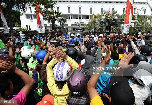 Indonesian workers and labor unions block the road during a protest demanding higher wages on October 31 2013 in Surabaya Indonesia Several...