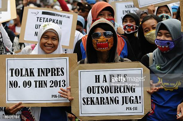 Indonesian workers and labor unions during a protest demanding higher wages on October 31 2013 in Surabaya Indonesia Several Indonesian labor unions...