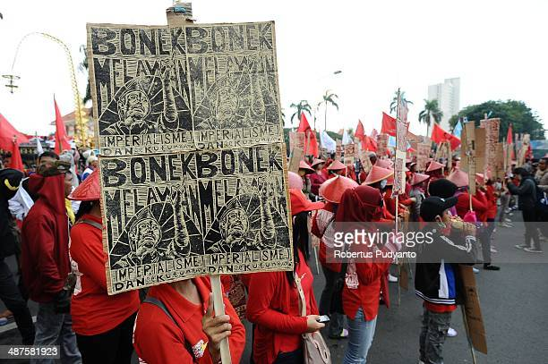 Indonesian workers march down the street to mark May Day on May 1 2014 in Surabaya Indonesia Protesters across Indonesia have organised rallies to...