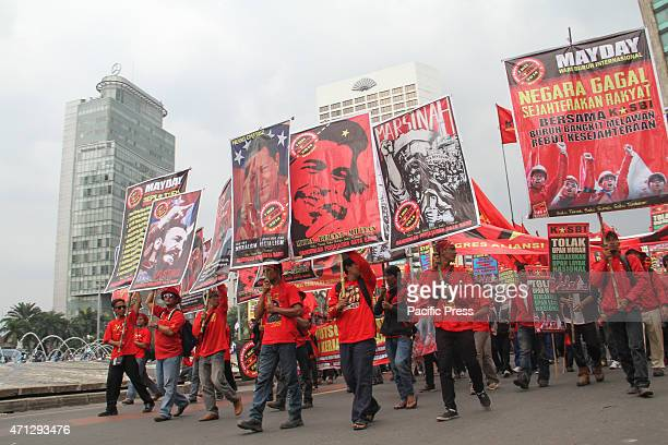 Indonesian workers march down the street to mark May Day Unions said up to two million workers would be out in force to demand better working...