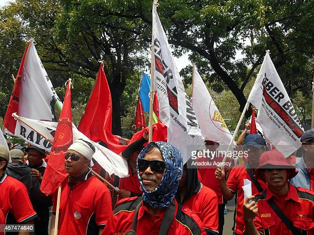 Indonesian workers shout slogans against government during a protest staged within a general strike going out in all over the country demanding rise...