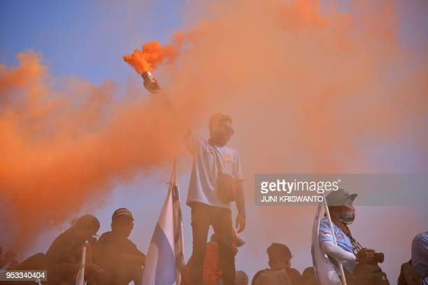 TOPSHOT Indonesian workers take part in a May Day rally in Surabaya on May 1 2018 Thousands of Indonesian workers took to the streets on May 1 to...