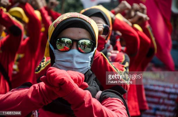 Indonesian workers take part in a protest to mark May Day or International Workers' Day in Bandung West Java Indonesia on May 1 2019