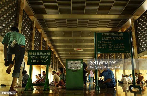 Indonesian worshipers enter the Masjid Istiqlal mosque in central Jakarta today for midday prayers Special donations were collected [in the green...