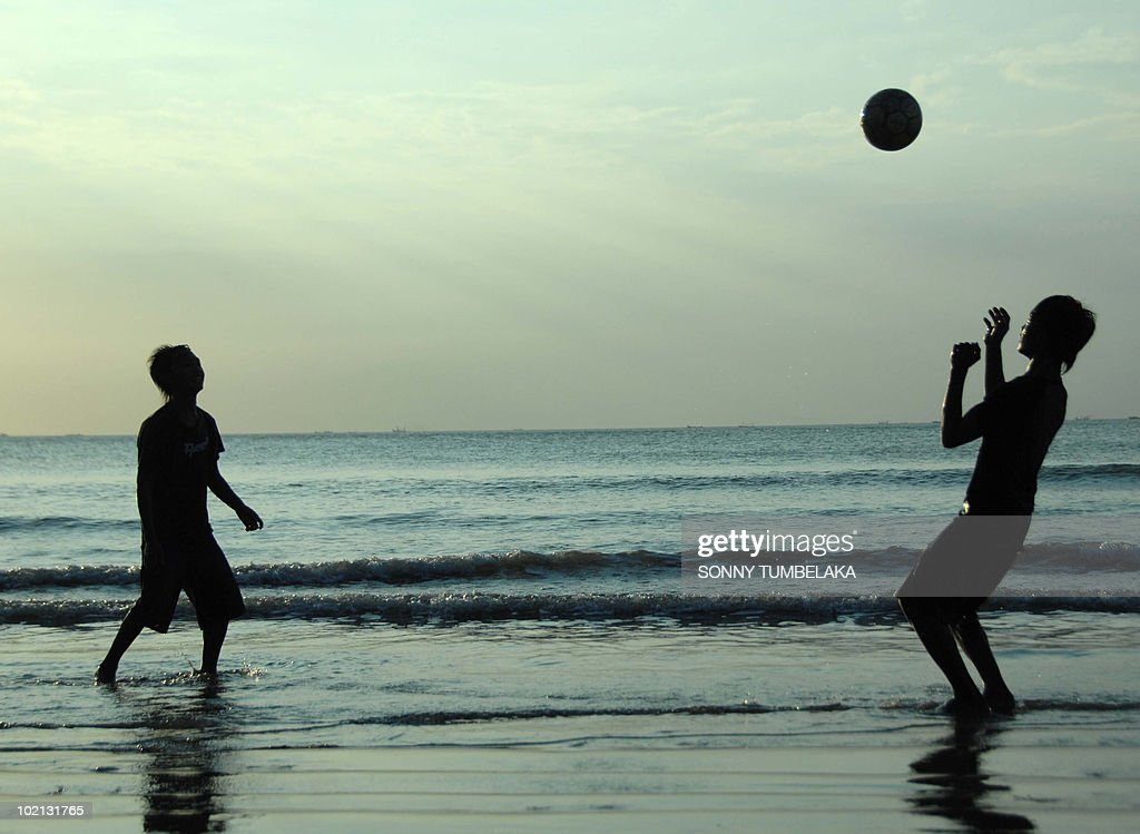 Indonesian youths play football at the beach in Jimbaran on resort island of Bali, on June 7, 2010. The one-month event of the 19th FIFA World Cup will begin on 11 June in South Africa.