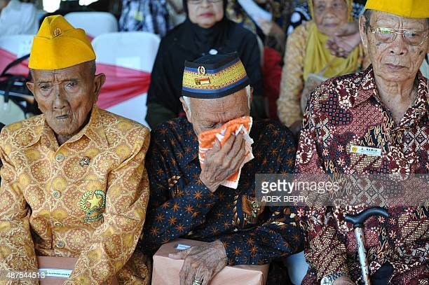 Indonesia-Netherlands-history,FEATURE by Olivia Rondonuwu This picture taken in Makassar on December 11, 2013 shows Indonesian veterans attending a...