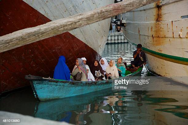 Indonesians arrive by boat for Eid Al Fitr prayers at the Sunda Kelapa port on July 17 2015 in Jakarta Indonesia Hundreds of Ship crews and port...