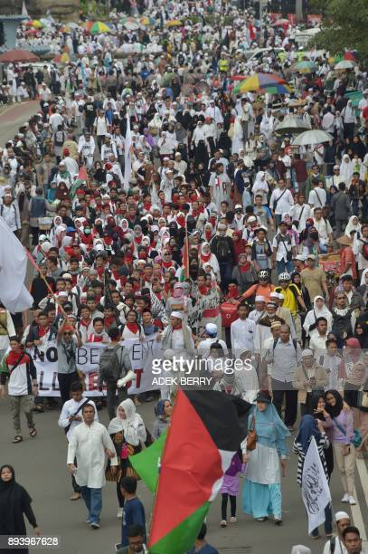 Indonesians attend a protest against US President Donald Trump's recent decision to recognise Jerusalem as the capital city of Israel, outside the US...