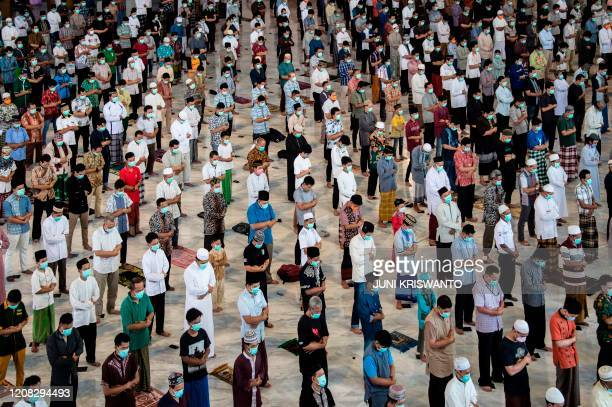 Indonesians attend Friday prayers at a mosque in Surabaya, East Java on March 27, 2020.