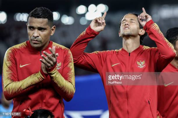 Indonesian's Beto Goncalves and Irfan Bachdim sing National Anthem during FIFA World Cup 2022 qualifying match between Indonesia and Thailand at the...