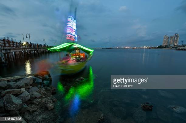 Indonesians enjoy the sunset at Jakarta Bay on June 7 a day before the World Oceans Day The World Oceans Day annually marked on June 8 is is a way to...