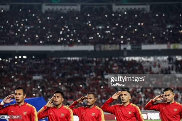 Indonesian's Hansamu Yama Pranata Zulfiandi Yustinus Paew Alberto Goncalves and Andritany Ardhiyasa sing National Anthem during FIFA World Cup 2022...