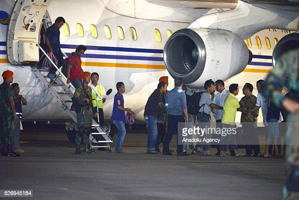 Indonesians kidnapped by Philippine rebel group Abu Sayyaf disembark a plane as they arrive at the Halim Perdanakusuma Airport in Jakarta Indonesia...