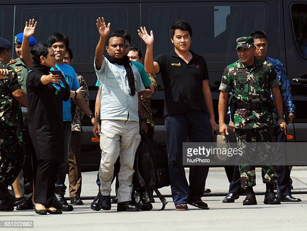 Indonesians kidnapped by Philippine rebel group Abu Sayyaf disembark from a plane as they arrive at the Halim Perdanakusuma Airport in Jakarta...
