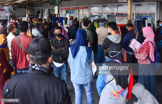 Indonesians line up in front of a bus station ticket box to get refund for their purchased tickets in Bekasi West Java on April 23 after the...