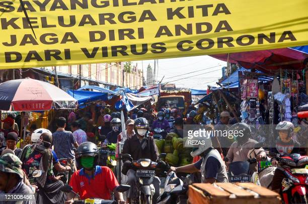 Indonesians look around a traditional market in Bekasi West Java on April 16 ignoring the social and physical distancing policy from the government...