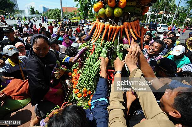 Indonesians Muslims fight over the fruit and vegetables during the Mawlid Mask Festival to commemorate the birthday of Prophet Mohammad on January 25...