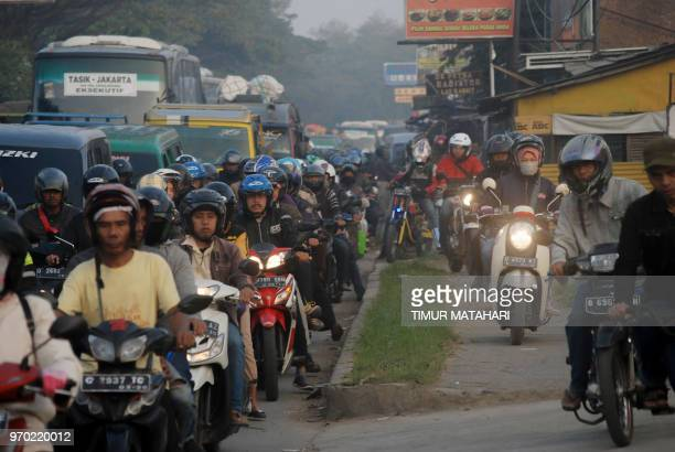 Indonesians pack the highway at southern of Bandung city in West Java on June 9 on their way to their hometowns to celebrate Eid alFitr with families...