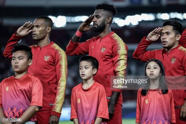 Indonesian's Ruben Sanadi Rudolof Yanto Basna and Andik Vermansah sing National Anthem during FIFA World Cup 2022 qualifying match between Indonesia...