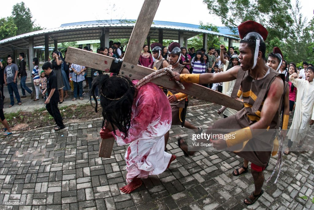 Indonesians take part in a re-enactment of the Stations Of The Cross on Good Friday at the Raja Agung church on April 18, 2014 in Bintan Island, Indonesia. Holy Week marks the last week of Lent and the beginning of Easter celebrations. Catholics make up approximately 3% per cent of the population of the predominantly Muslim country.
