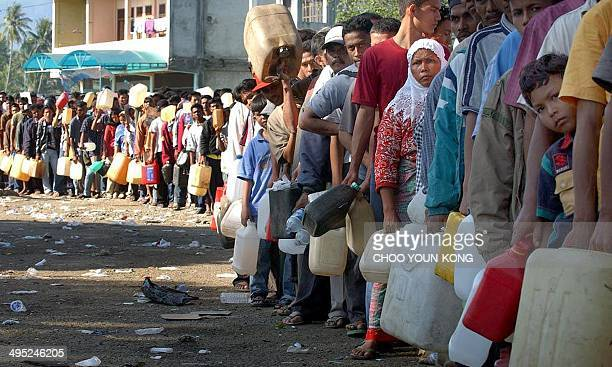 Indonesians wait to buy gasoline in a long line as people have been waiting for three days at the petrol station near Banda Aceh Indonesia 30...