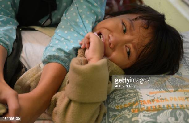 STORY 'IndonesiareligionIslamhealthwomenrightsFEATURE' by Arlina Arshad This picture taken on February 10 2013 shows a young Indonesian girl crying...