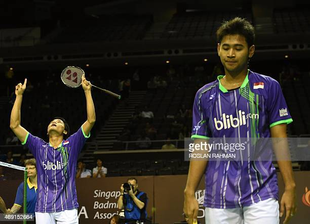 Indonesia's Angga Pratama and Ricky Karanda Suwardi reacts after defeating South Korea's Lee Yong Dae and Yoo Yeon Seong in their men's double...