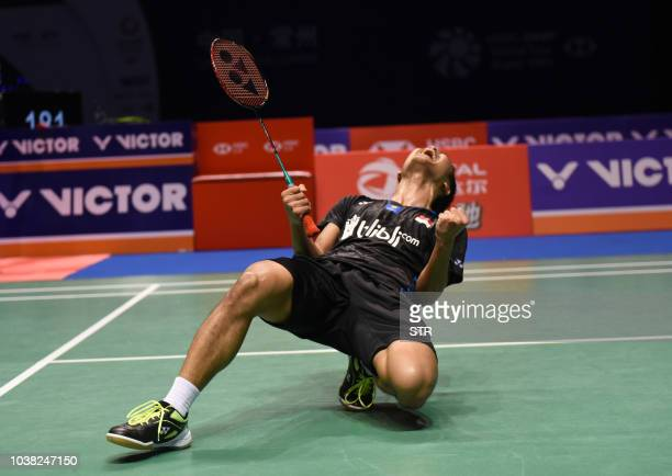 Indonesia's Anthony Sinisuka Ginting celebrates his win over Japan's Kento Momota in the men's final match of the China Open 2018 badminton...