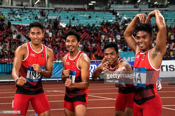 Indonesia's athletes celebrate after winning a heat of the men's 4x100m relay athletics event during the 2018 Asian Games in Jakarta on August 29,...