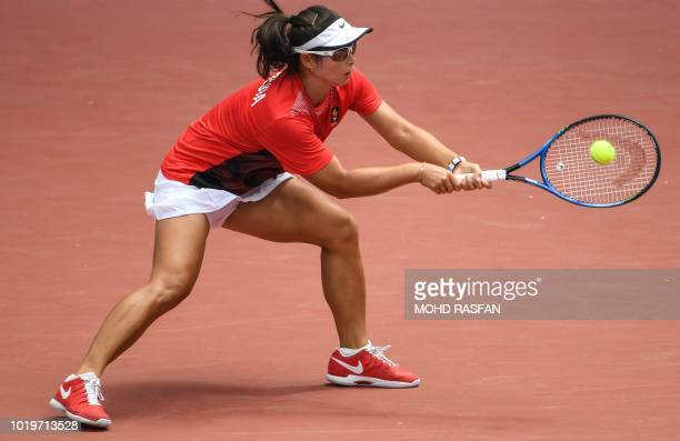 Indonesia's Beatrice Gumulya hits a return against India's Ankita Ravinderkrishan Raina in their women's singles tennis match during the 2018 Asian...