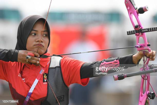 Indonesia's Choirunisa Diananda in action during the Archery Recurve Women's Individual Final Asian Games 18th against China's Zhang Xinyan at...