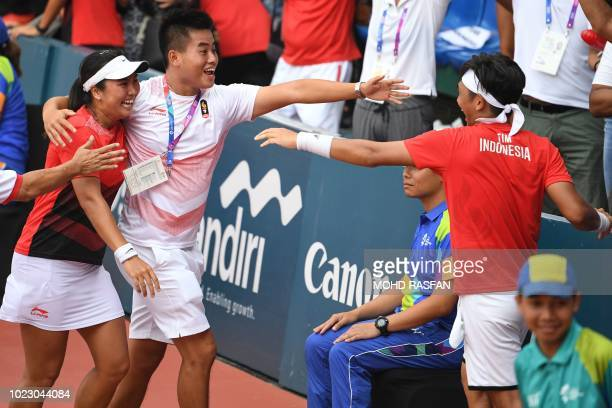 Indonesia's Christopher Benjamin Rungkat and Aldila Sutjiadi celebrate their gold medal win against Thailand during the mixed doubles tennis at the...